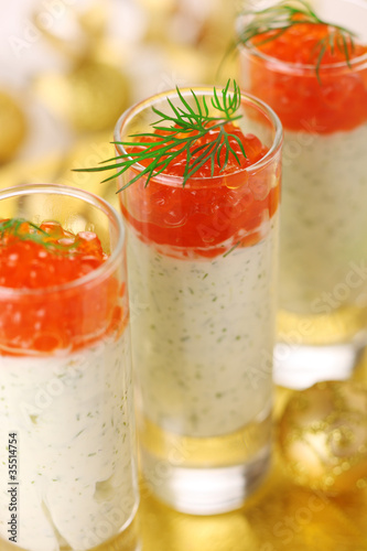Appetizer with cream cheese and red caviar for Christmas table