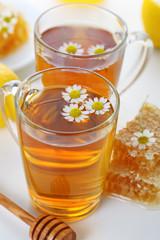 cup of herbal tea with chamomile flowers and honey -healthy life