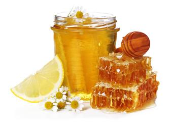 Fresh honey, chamomile and lemon on white isolated background