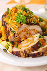 Stuffed pork roast with dried apricots and nuts