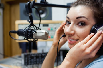 Close up of a young radio host posing