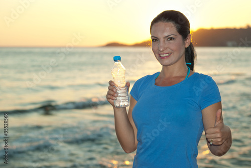 Successful athlete woman give thumb