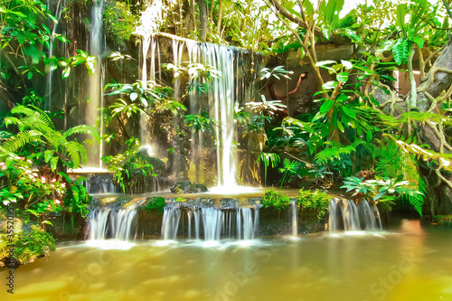 Beautiful tropical man-made garden waterfalls
