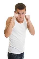A man compresses his fists