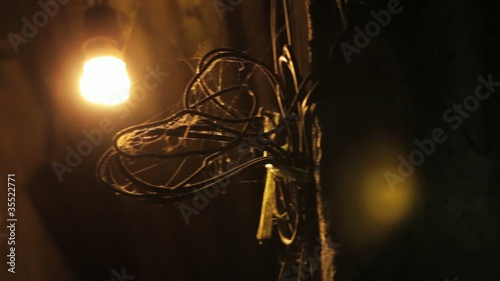 Cobwebbed Wires in a Dark Alleyway