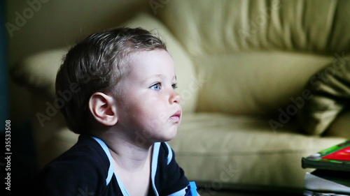 Baby Boy with Blue Eyes watching TV