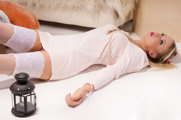 Sensual blonde lying on the floor