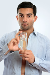 Man holding glass bottle men's cologne