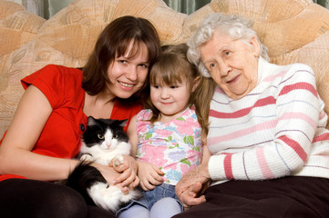 Family on sofa with a cat