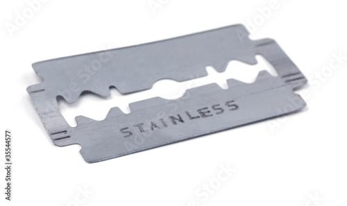 Old razor blade isolated on white