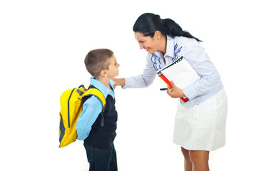 Teacher talking with schoolboy