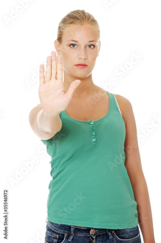 Young woman making stop gesture.