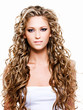 Beautiful woman with long curly hair on white