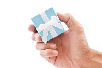 Hand Holding a Ring Gift Box