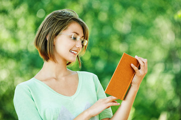 young woman glasses read book