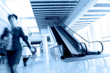 people rushing on escalator