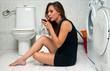 woman drinks wine in her bathroom