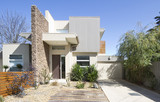 Fototapety Facade of a contemporary double storey townhouse home