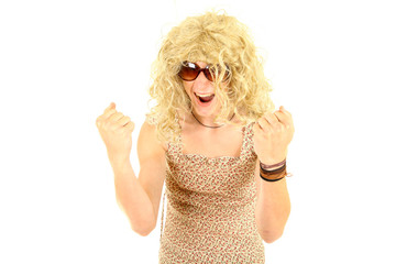 excited young man in wig and dressed as woman