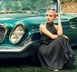 Beautiful lady sitting near retro convertible.