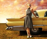 Beautiful lady standing near retro car.