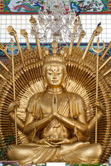 Golden Kuan Yin Statue in Temple