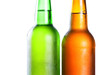 Topping of green and brown bottle with light beer with condensat