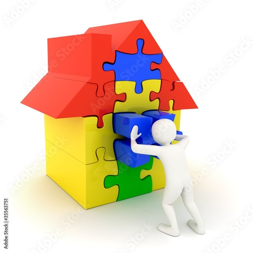 White man pushing in place puzzle house piece