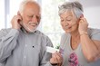 Senior couple with mp3 player