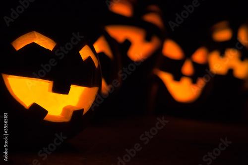 Carved Jack-o-lanterns lit for Halloween - 35565181
