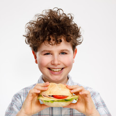 Boy eating big sandwich