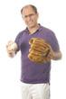middle age senior man softball throwing into baseball glove on