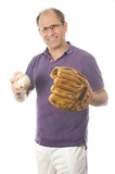 middle age senior man softball throwing into baseball glove on