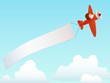 Red plane with advertising banner in sky