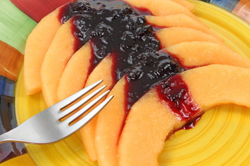 Cantaloupe with blueberry sauce