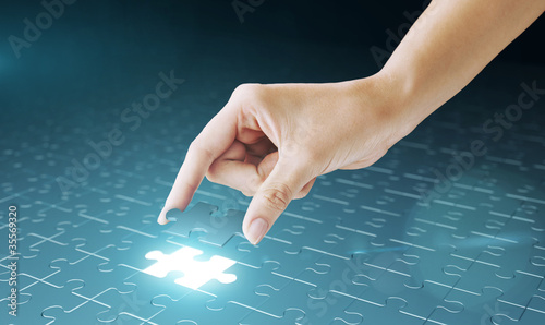 Hand embed missing puzzle piece into place