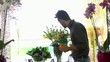 Young woman and client talking in flowers shop