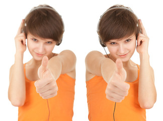 young woman listening music in headphones with thumb up