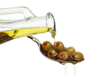 Pouring oil on olives