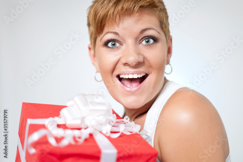 surprised  girl holding present