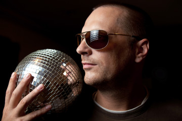 attractive man with disco ball