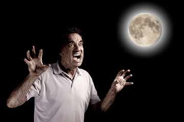 Scary Man Werewolf Fango Beast under Full Moon at Halloween