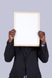 african businessman holding a whiteboard