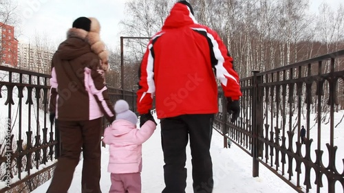 Mom and Dad and baby girl exeunt on bridge