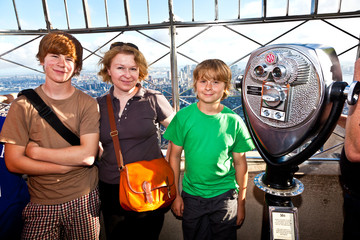 family on platform of Empire State building enjoys the vacation