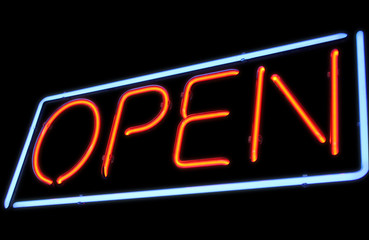 Open neon sign by night