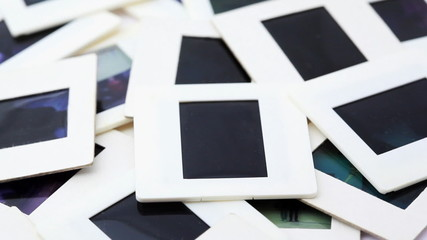Bunch of slides in white framed rotates counterclockwise