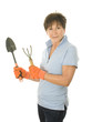 middle age senior woman gardener with spade and cultivator tools