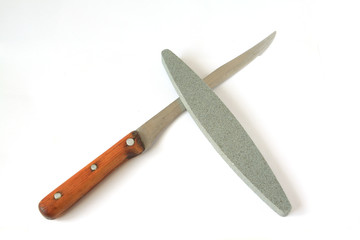 knife and emery on white background