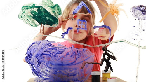 Little girl begins to paint house wall in picture on glass
